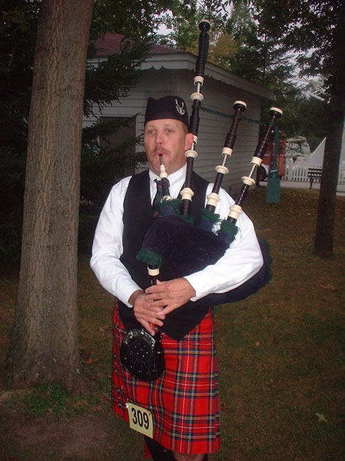 Baltimore Bagpiper Paul Cora playing moving tunes on his bagpipes