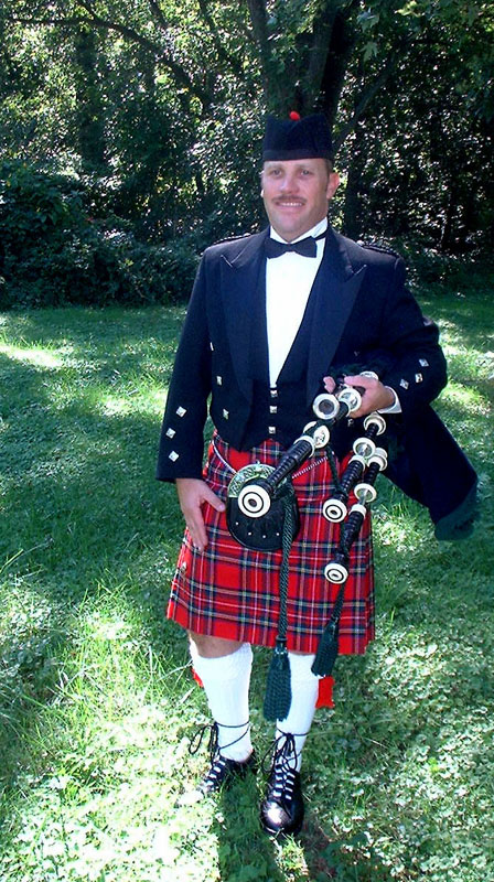 Baltimore Bagpiper Paul Cora taking a break from piping music on his bagpipes